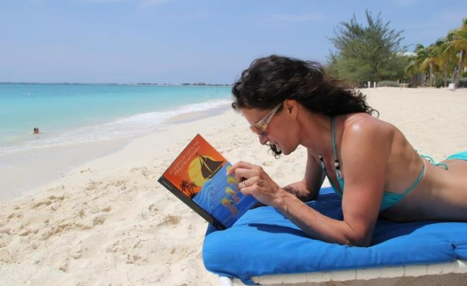 Women reading In Search of Cap'n Tim around the world