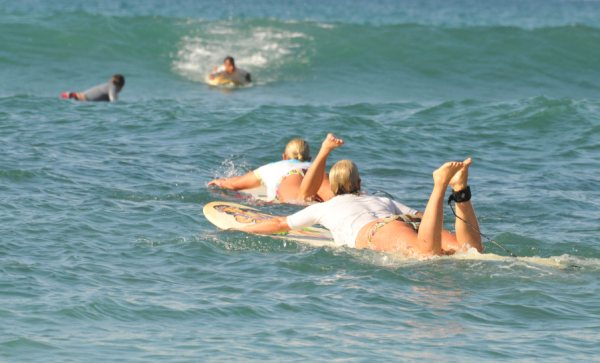 Pinkie and Peaches on the paddle out